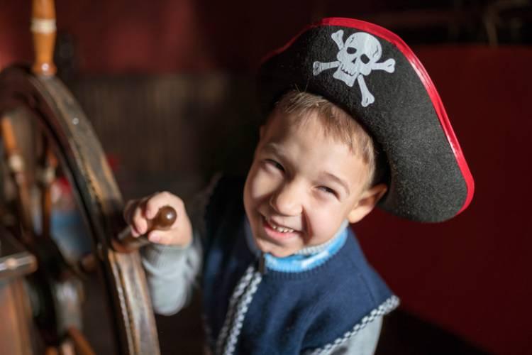 A little boy explores a pirate museum