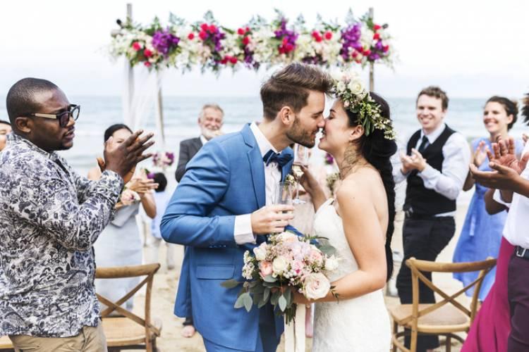 A couple celebrates a beach wedding